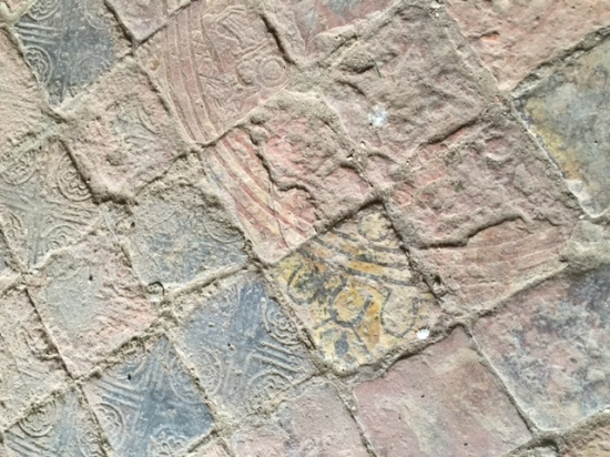 Amazing to find in situ glazed floor tiles amidst the ruins, albeit in the Muniment Room which has kept its vaulted roof to act as protection.